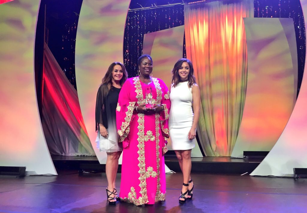 Mama Shu (Center) poses with eWomen Network Founder Sandra Yancey (Left) upon receiving the 2016 Humanitarian of the Year Award